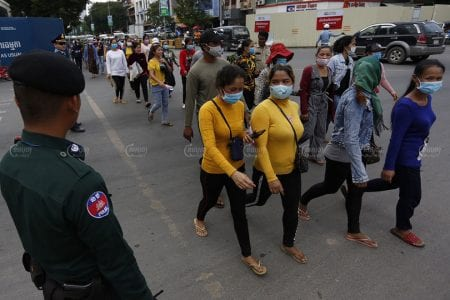 A group of about 100 workers of Violet Apparel garment march to the Ministry of Labor on July 23 after police officers blocked them from submitting a petition at Prime Minister Hun Sen's house. Panha Chhorpoan