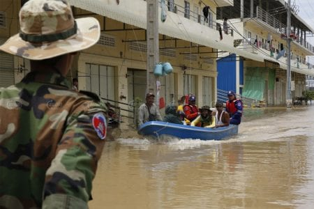 Dangkor district residents head home on a motorboat accompanied by rescue officials on October 20. Panha Chhorpoan