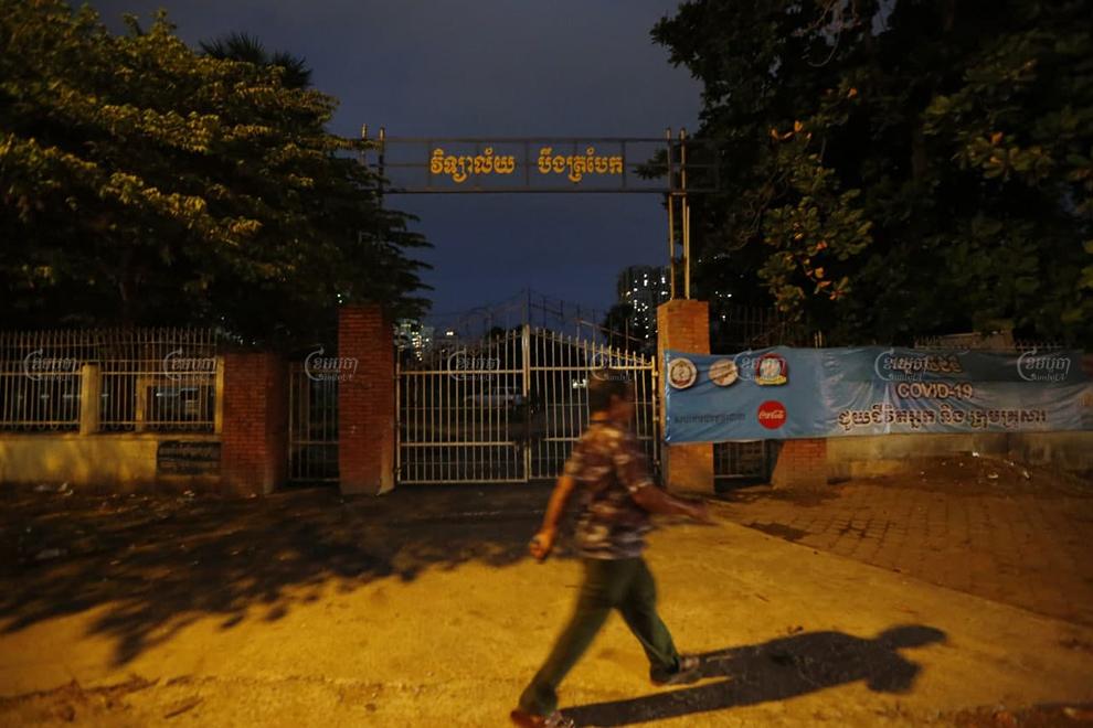 A man walks cross Boeng Trabek High School in Phnom Penh on November 8. Panha Chhorpoan