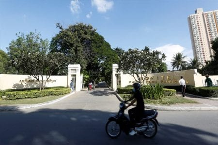 A motorist rides past the Sofitel Phnom Penh Phokeethra on Wednesday in Phnom Penh's Chamkarmon district. Panha Chhorpoan