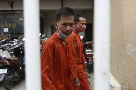 Newspaper publisher Ros Sokhet arrives at the Phnom Penh Municipal Court on November 11, where he was sentenced to 18 months for incitement. Panha Chhorpoan
