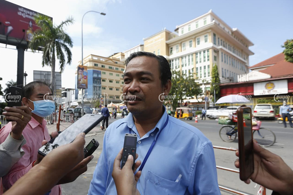 Defense lawyer Sam Sokong speaks to journalists after his clients' trial at Phnom Penh Municipal Court on Wednesday. Panha Chhorpoan