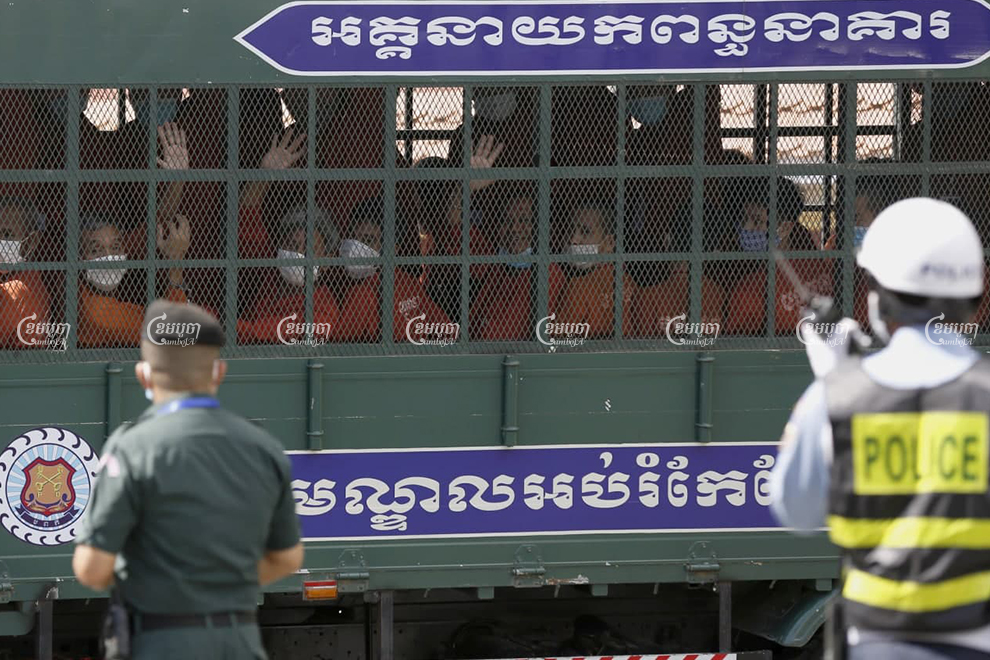 Former CNRP officials leave Phnom Penh municipality court in a prison van after their trial on Tuesday. Panha Chhorpoan