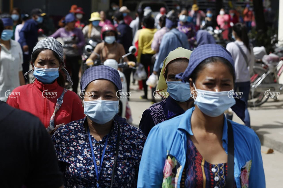 Garment workers leave the factory premises in Phnom Penh for a lunch break on December 2, 2020. Panha Chhorpoan