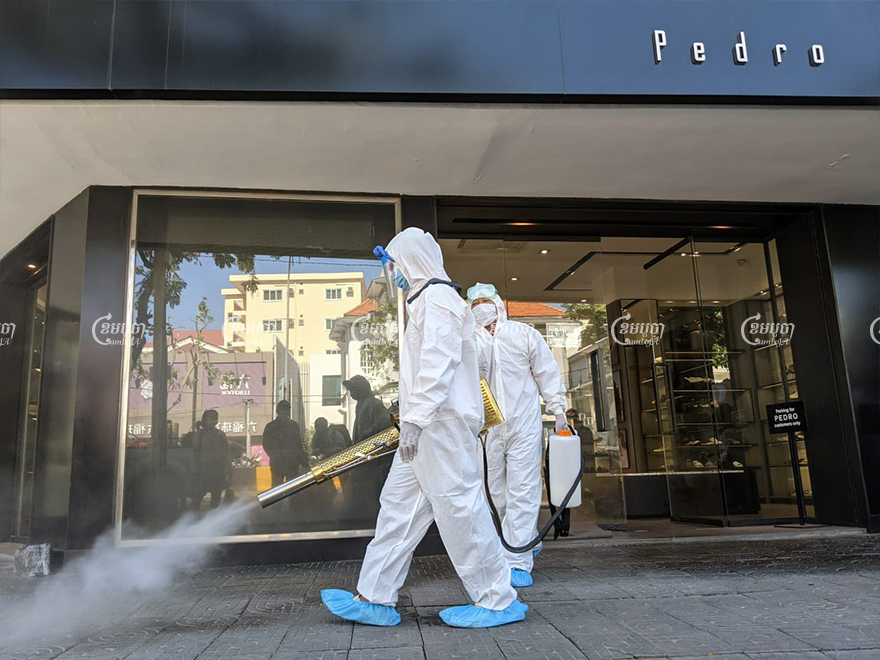 Health workers disinfect a fashion store in Phnom Penh where at least seven staff members have tested positive for COVID-19 since November 28. Panha Chhorpoan