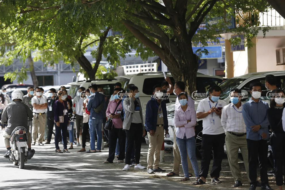 Interior Ministry employees line up to get tested on Monday morning, after another ministry official tested positive for COVID-19. Panha Chhorpoan