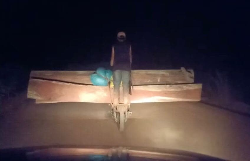 A screenshot of a video provided by Kin Sary shows logs being transported in Kratie province on November 16.