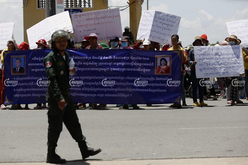 About 200 workers who were marching to the Kandal Provincial Court in Takhmao City on July 13 to submit a petition asking that the court remove an injunction preventing them from being paid by their former factory owner. Panha Chhorpoan