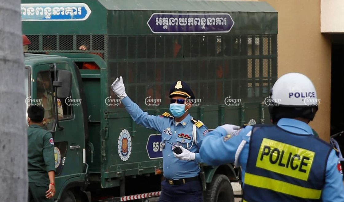 Defendants arrive at the Phnom Penh Municipal Court on Thursday ahead of hearings in widely condemned trials of members and affiliates of the outlawed Cambodian National Rescue Party. Panha Chhorpoan