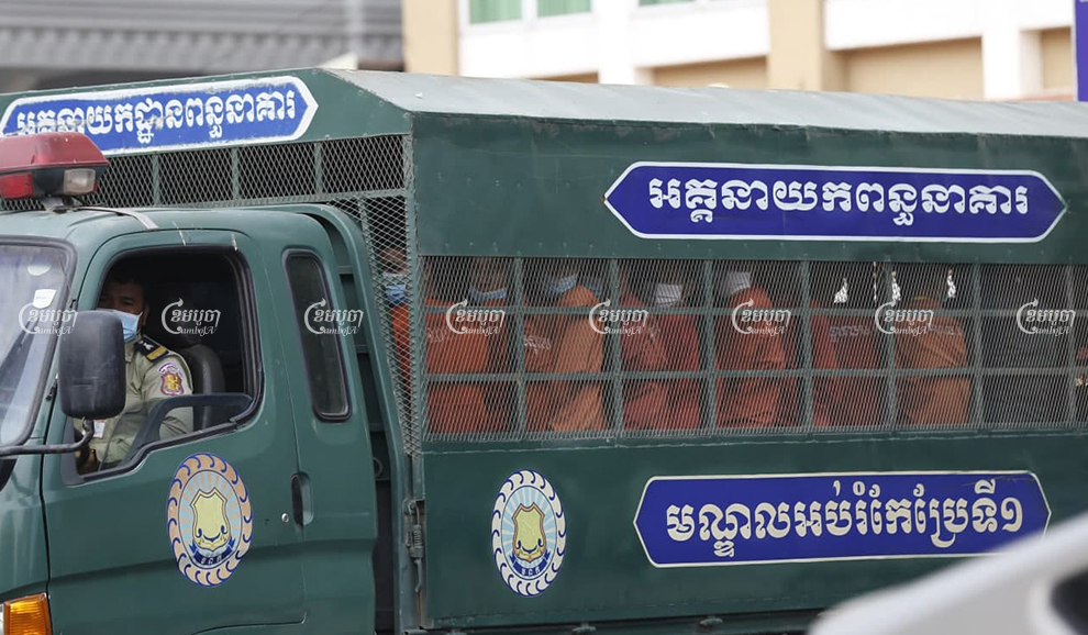 Former CNRP officials leave Phnom Penh Municipal Court in a prison truck on December 30 after being convicted on incitement charges related to Sam Rainsy's failed plan to return to Cambodia in 2019. Panha Chhorpoan
