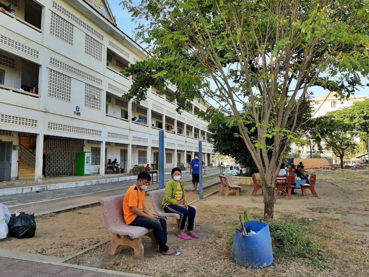 Cambodian migrant workers returning from Thailand are quarantined at a high school in Battambang province in a photo posted to the provincial administration's Facebook page.
