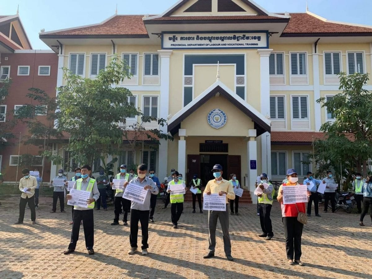 Workers laid-off from the Siem Reap International Airport protest to demand bonuses paid in full outside the provincial labor department on Friday. CTWF