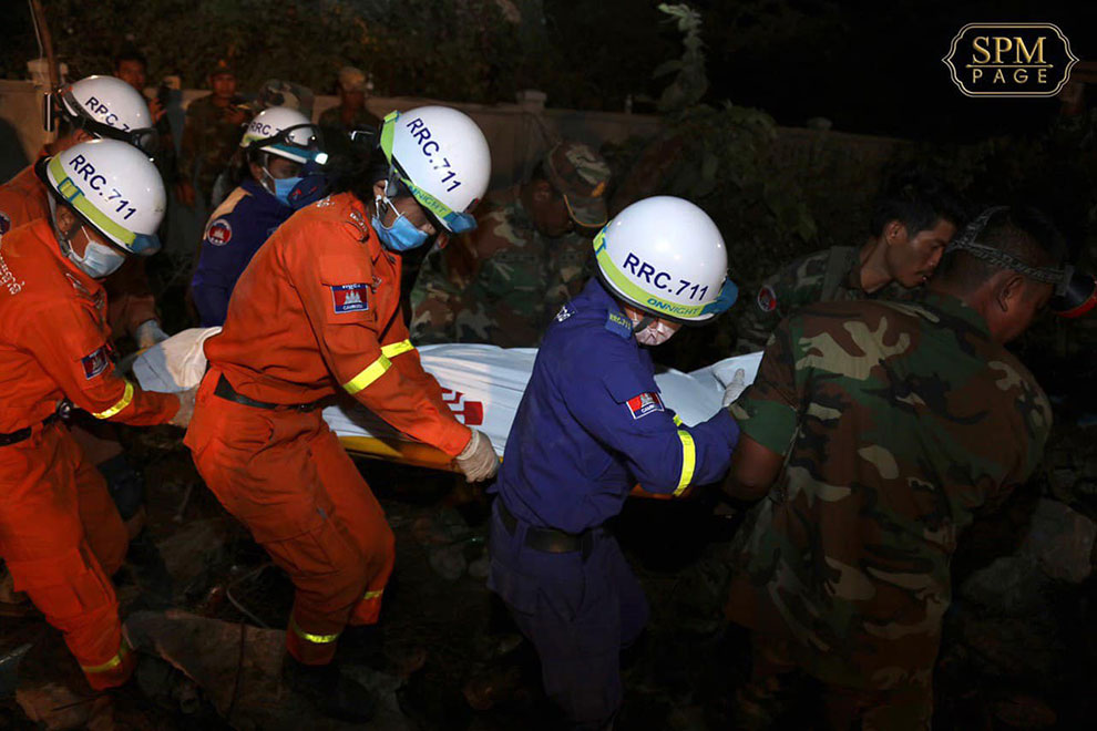 Rescue teams work to remove people trapped under the collapsed Kep building in January 2020.