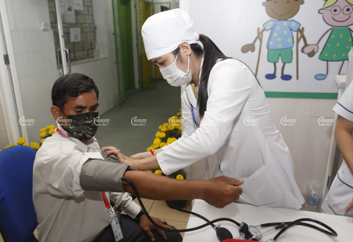 A Cambodian journalist is given a health check before being administered the Sinopharm COVID-19 vaccine at a Phnom Penh hospital on Wednesday. Panha Chhorpoan