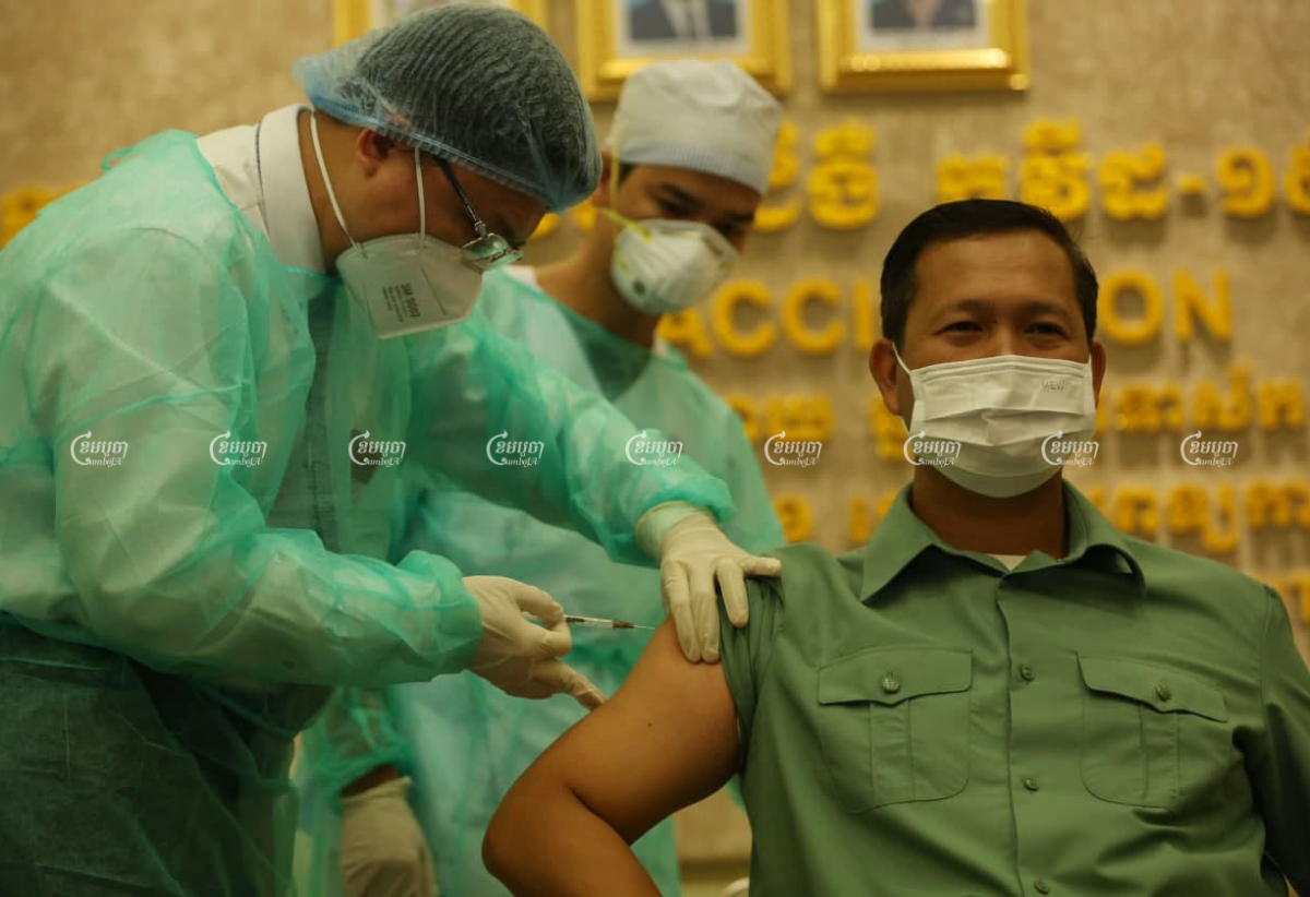 Hun Manet, Hun Sen's son and Army Commander, gets the Sinopharm vaccine at Calmette Hospital on Wednesday, as the government started its vaccination drive. Pring Samrang