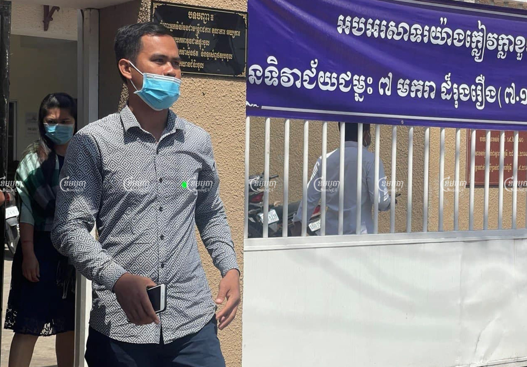 Hy Sokchea, one of the defendants in a mass trial against former CNRP members, leaves the Phnom Penh Municipal Court after Thursday's hearing. Khuon Narim