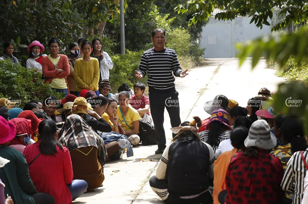 Phin Sophea, a representative for workers at the shuttered Dignity Knitter and ECO Base factories, speaks to colleagues after meeting with authorities to discuss plans to pay outstanding salaries and bonuses following the auction of equipment seized from the factories. Panha Chhorpoan