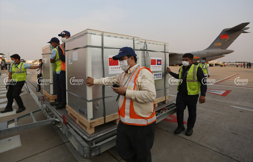 The first COVID-19 vaccines donated by China to Cambodia arrive at Phnom Penh International airport on Sunday. Pring Samrang