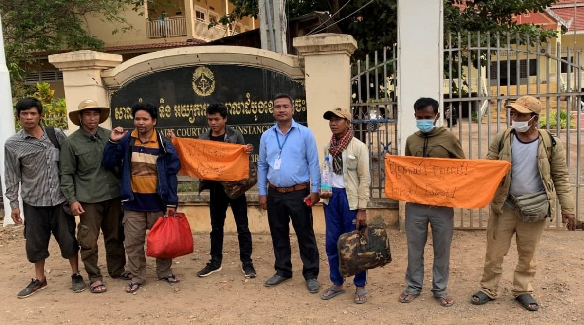 The five activists stand outside the Kratie Provincial Court with rights monitors and supporters, shortly after they were released Monday morning. Adhoc