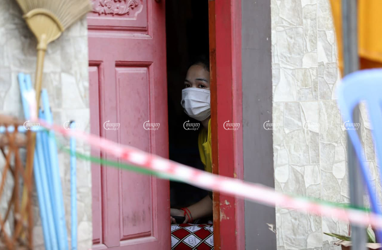 A garment worker is shown quarantined in her rental room after her roommate tested positive for Covid-19, on March 17, 2021. CamboJA/ Pring Samrang