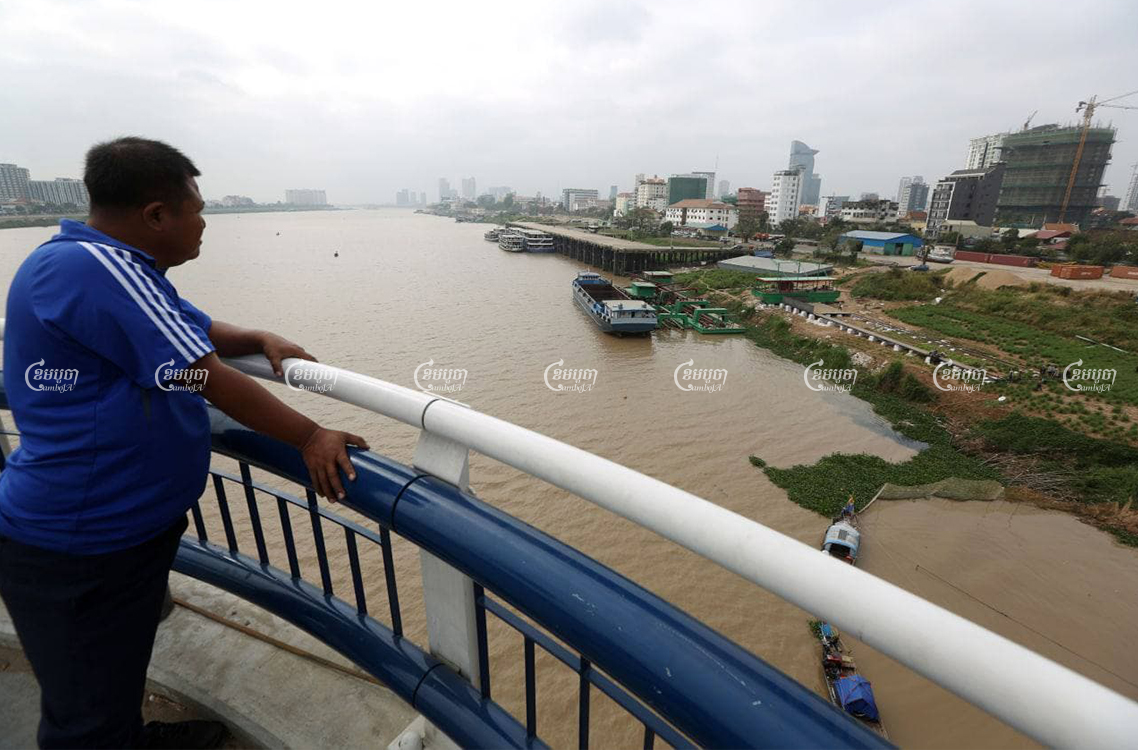 A man looks from the Chroy Changvar bridge at the site of Yuetai Group's City Gate development in Phnom Penh, on February 24, 2021. CamboJA/ Pring Samrang