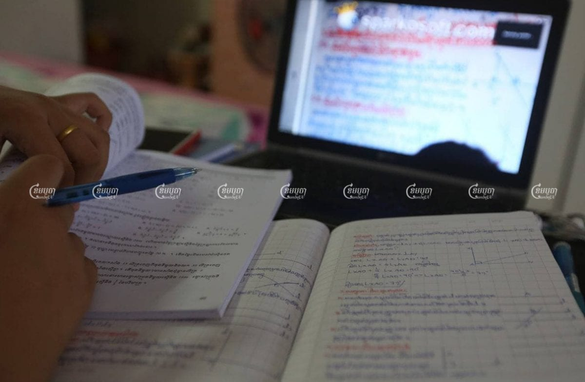 A student completes online lessons at home in Phnom Penh, March 11, 2021. CamboJA/ Pring Samrang