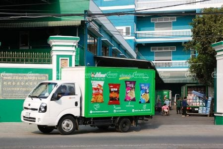 A truck leaves the LY LY Food Industry, an SME food manufacturer, premises on March 30. CamboJA/ Panha Chhorpoan
