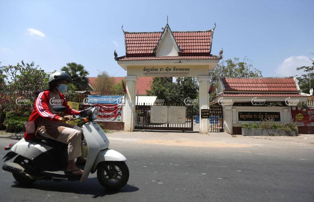 A woman drives past a closed school in Phnom Penh, March 11, 2021. CamboJA/ Pring Samrang
