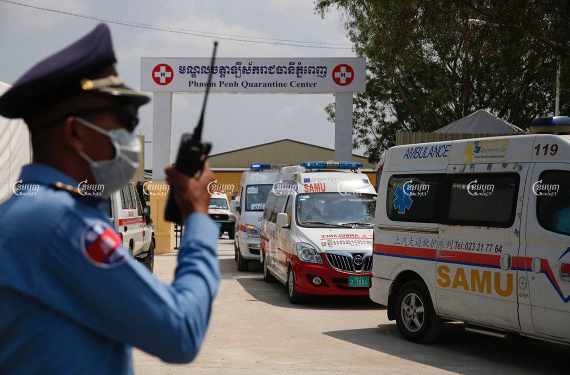 Ambulances leave the Phnom Penh Quarantine Center with COVID-19 patients after Prime Minister Hun Sen ordered that people in quarantine and infected patients should not be kept at the same site. CamboJA/ Panha Chhorpoan