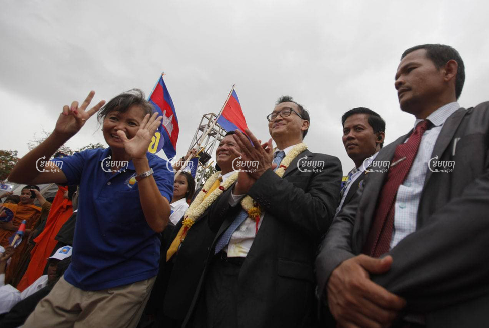 Cambodia National Rescue Party lawmakers (from L) Mu Sochua, Kem Sokha, Sam Rainsy and Long Ry greet supporters at Freedom Park in Phnom Penh after Rainsy returned to Cambodia, on July 19, 2013.CamboJA/ Pring Samrang
