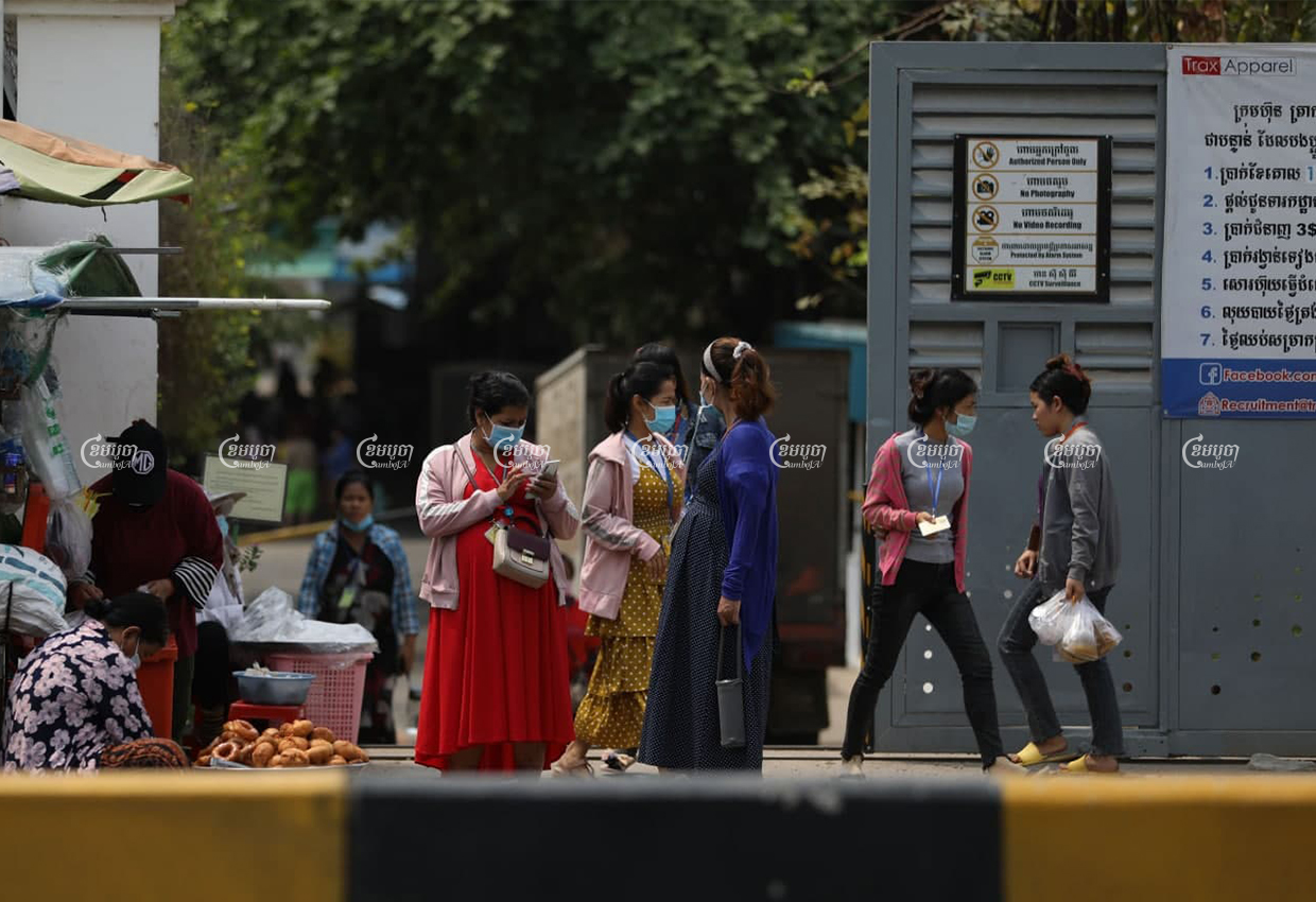 Garment workers buy food in front of the Trax Apparel factory, one day after a factory guard was brought to the hospital upon testing positive for Covid-19, March 17, 2021. CamboJA/ Pring Samrang