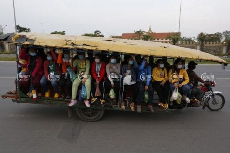 Garment workers travel home from work at a factory on the outskirts of Phnom Penh, March 2, 2021. Panha Chhorpoan