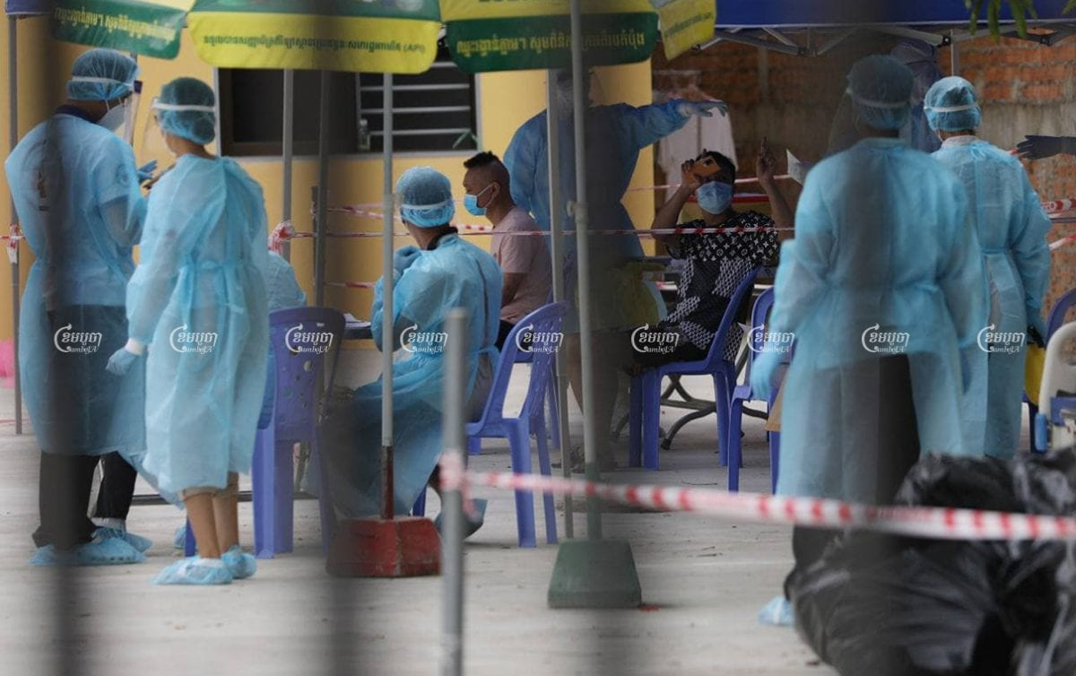 People line up for a health check at the quarantine center in Phnom Penh on March 3, 2021. CamboJA/ Pring Samrang