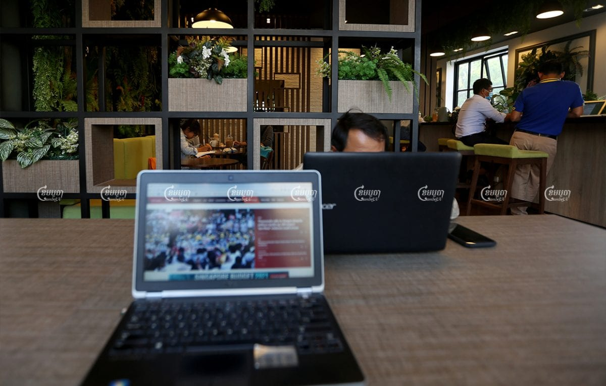 People use free wi-fi at a coffee shop in Phnom Penh, February 2021. CamboJA/ Pring Samrang