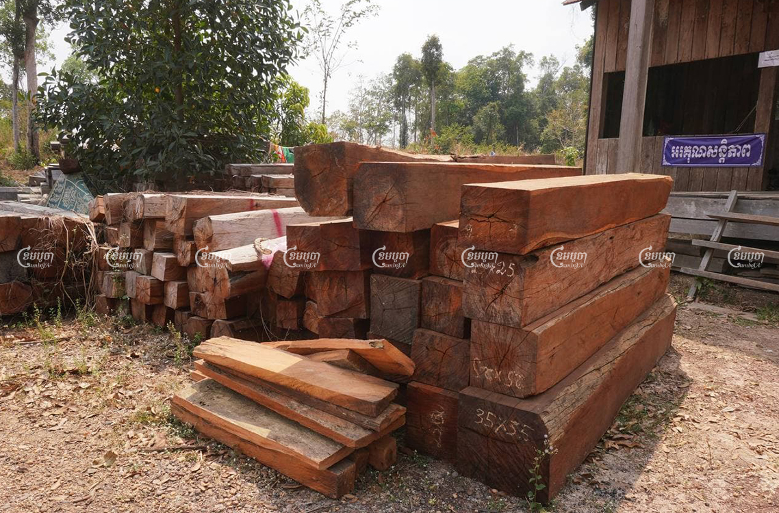 Timber seized from the Prey Lang Wildlife Sanctuary is stored at a government building in Kratie province. Panha Chhorpoan