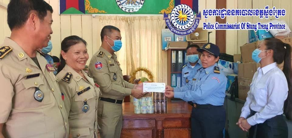 Stung Treng police hand over money and gifts to Siem Pang police officer Sithung Sokha after initially reprimanding her for breastfeeding on the job and in public. Facebook