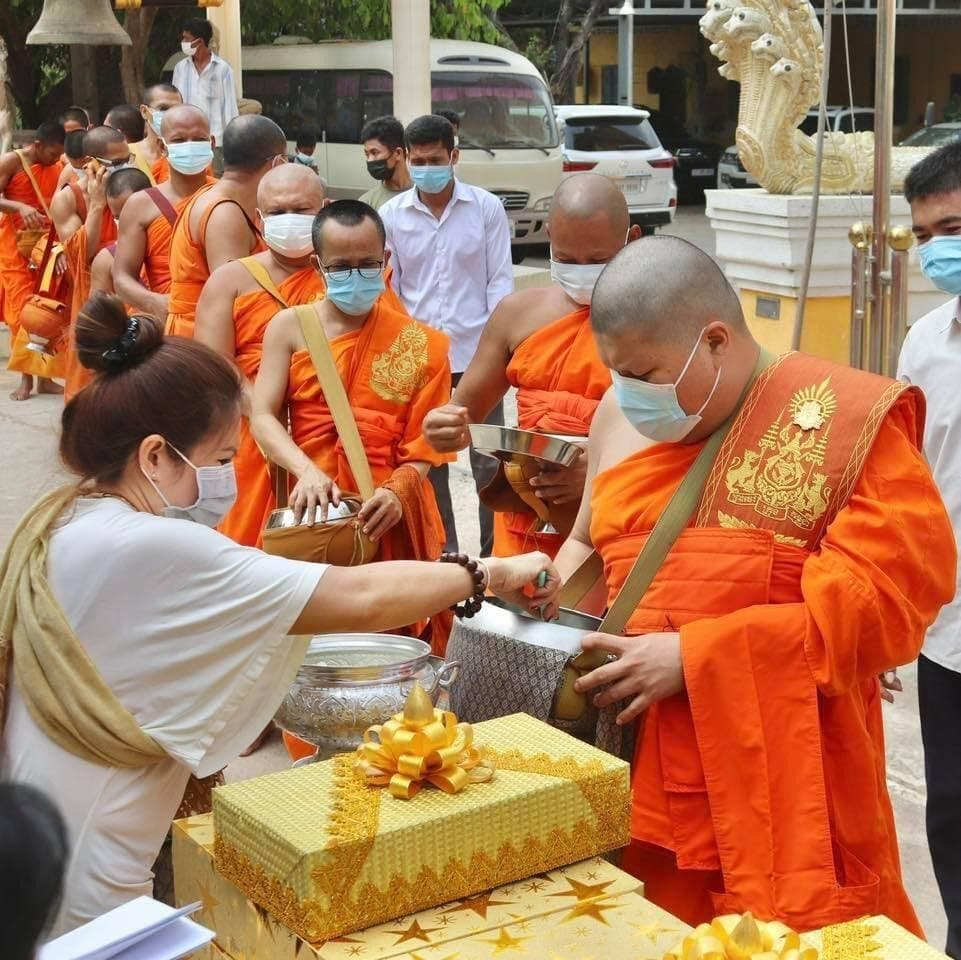 Duong Chhay stands in line to receive alms, in this photo posted on his Facebook page on Sunday.