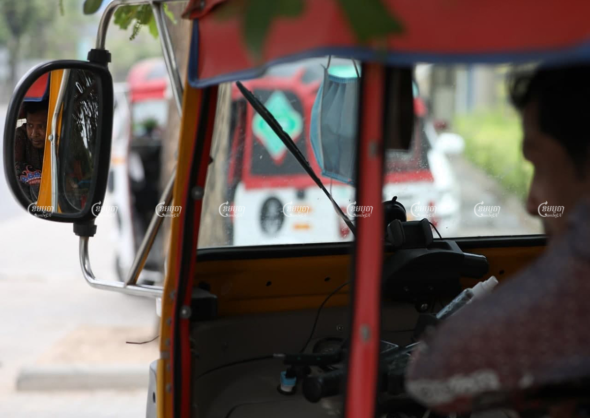 A tuk-tuk driver wait for costumers near a market in Phnom Penh, April 6, 2021. CamboJA/ Pring Samrang