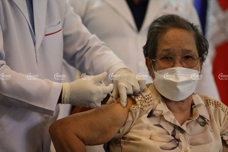A woman receives a dose of the COVID-19 vaccine in Phnom Penh, April 1, 2021. CamboJA/ Pring Samrang