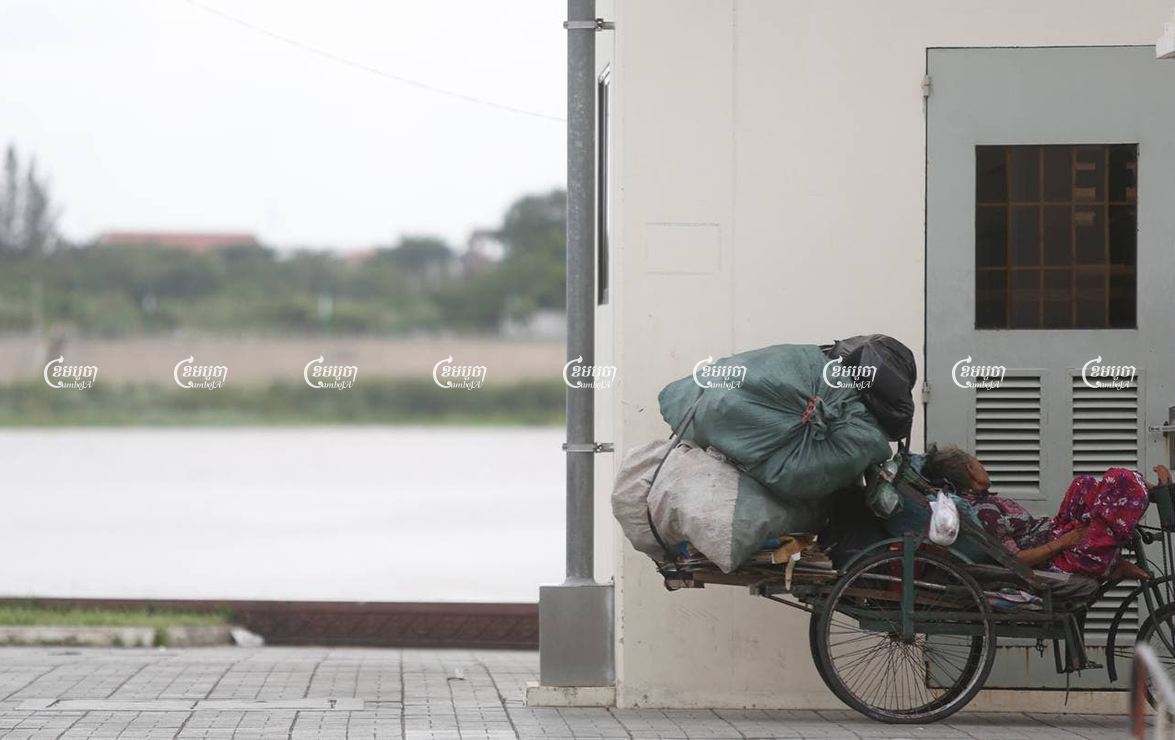 A woman with disabilities rests on her scrap cart near the Tonle Sap river in Phnom Penh, August 16, 2016. CamboJA/ Pring Samrang