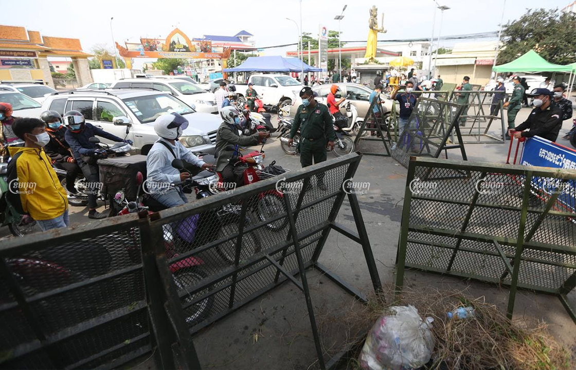 Authorities block the street at the border of the Phnom Penh and Takhmao City, Kandal, on the first day of lockdown , April 15, 2021. CamboJA/ Pring Samrang