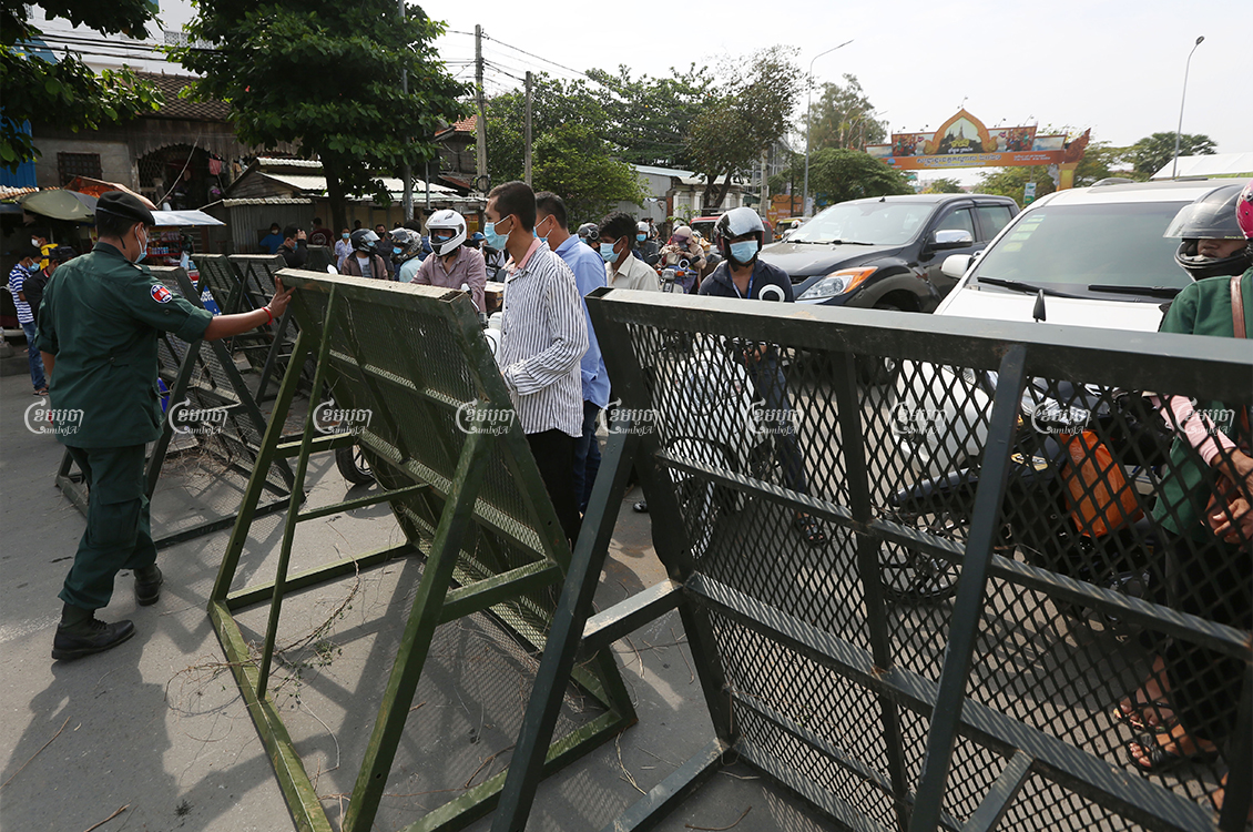 Authorities lock down the main road from Takhmao in Kandal province to nearby Phnom Penh after Prime Minister Hun Sen announced on Wednesday night a two-week lockdown of the metro area, April 15, 2021. CamboJA/ Pring Samrang