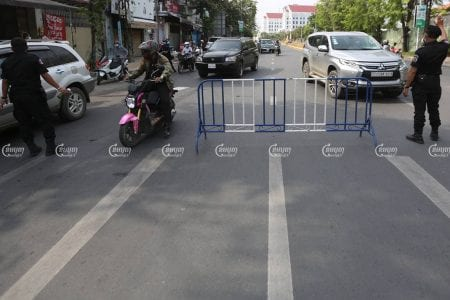 Authorities man a barricade in Phnom Penh after the two-week lockdown went into effect, April 15, 2021. CamboJA/ Pring Samrang