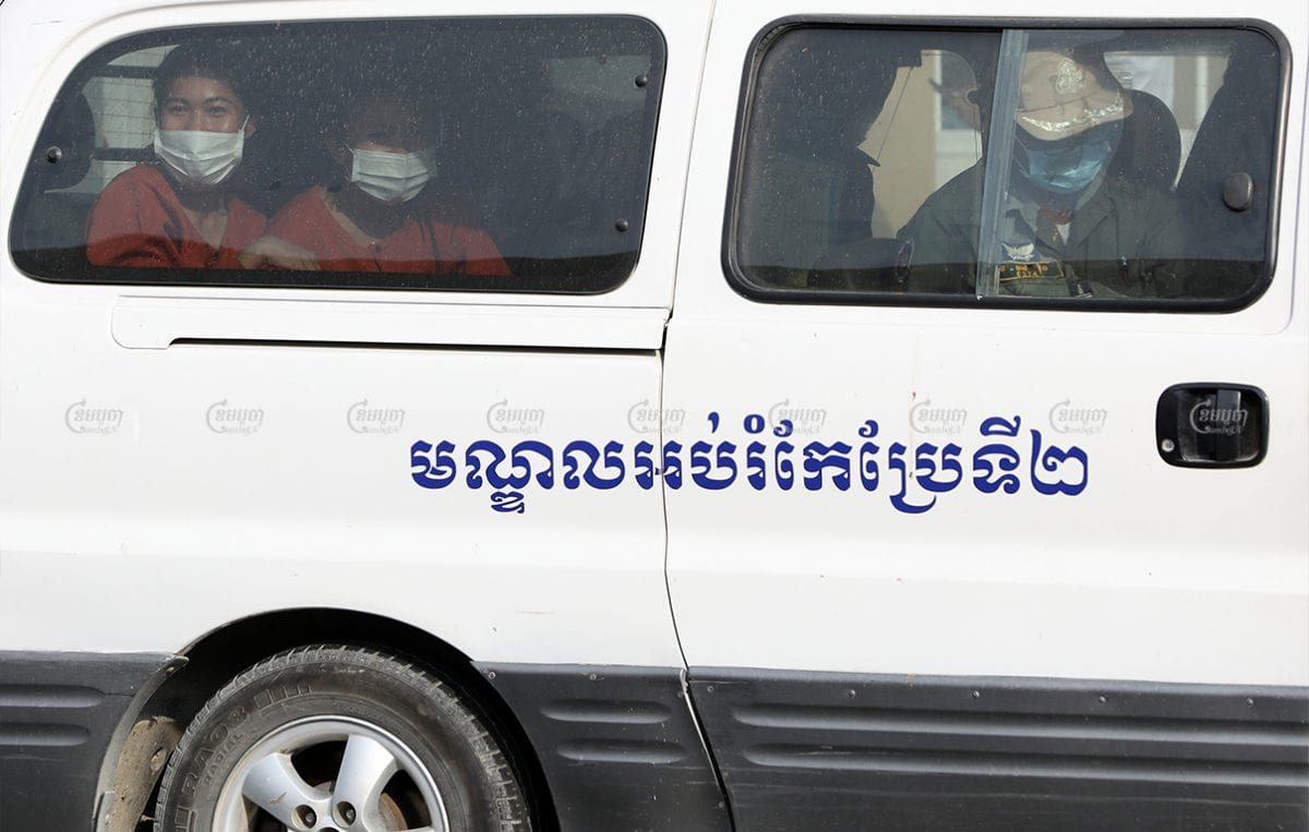 Environmental activists from advocacy group Mother Nature arrive at Phnom Penh Municipal Court for their hearing, April 8, 2021. CamboJA/ Pring Samrang