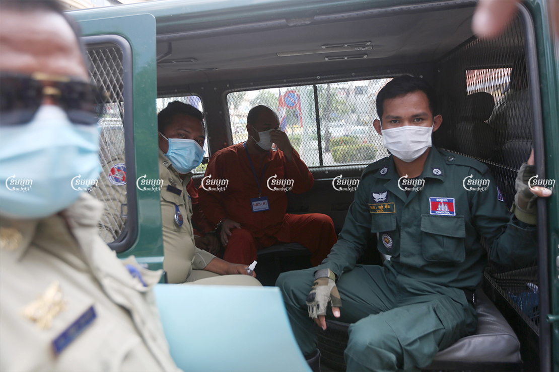 Former police general Ung Chanthuok arrives at Phnom Penh Municipal court ahead of his trial for breaching COVID lockdown guidelines, April 29, 2021. CamboJA/ Pring Samrang