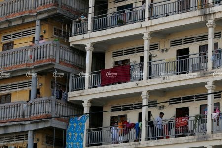 Garment workers stand in front of their rented apartments in the Stung Meanchey III commune of Meanchey district, one of the strictly patrolled COVID-19 red zones in Phnom Penh, April 22, 2021. CamboJA/ Panha Chhorpoan