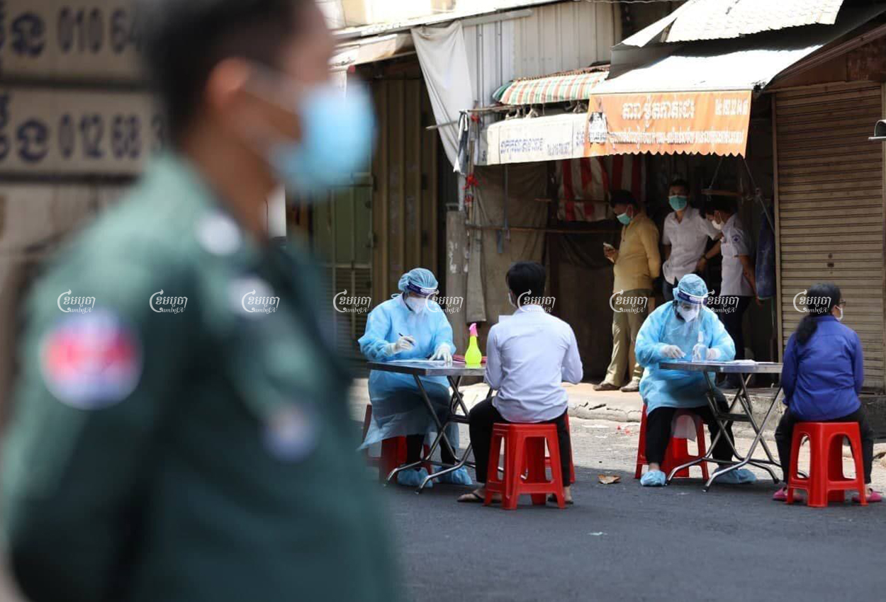 Healthcare workers take details of staff at a restaurant linked to the COVID-19 cluster at O'Russei market, in Phnom Penh, April 5, 2021. CamboJA/ Pring Samrang