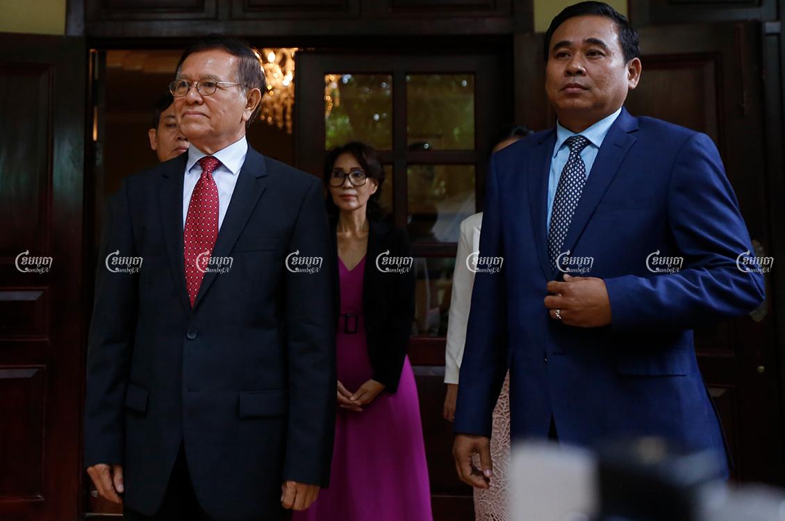 Kem Sokha's Cabinet Chief Muth Chantha (R), and Kem Sokha wait to meet visitors, in Phnom Penh, November 11, 2019. CamboJA/ Pring Samrang