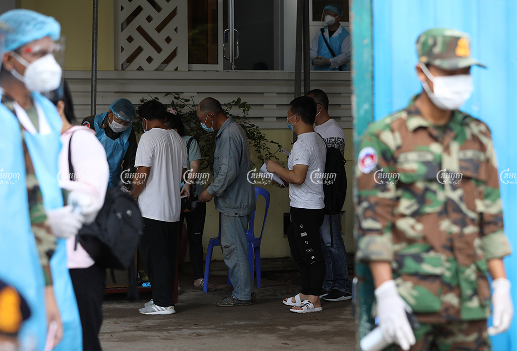 Military medical staff check documents of Chinese nationals before providing them with vaccinations at Preah Ket Mealea Hospital, April 10, 2021. CamboJA/ Pring Samrang