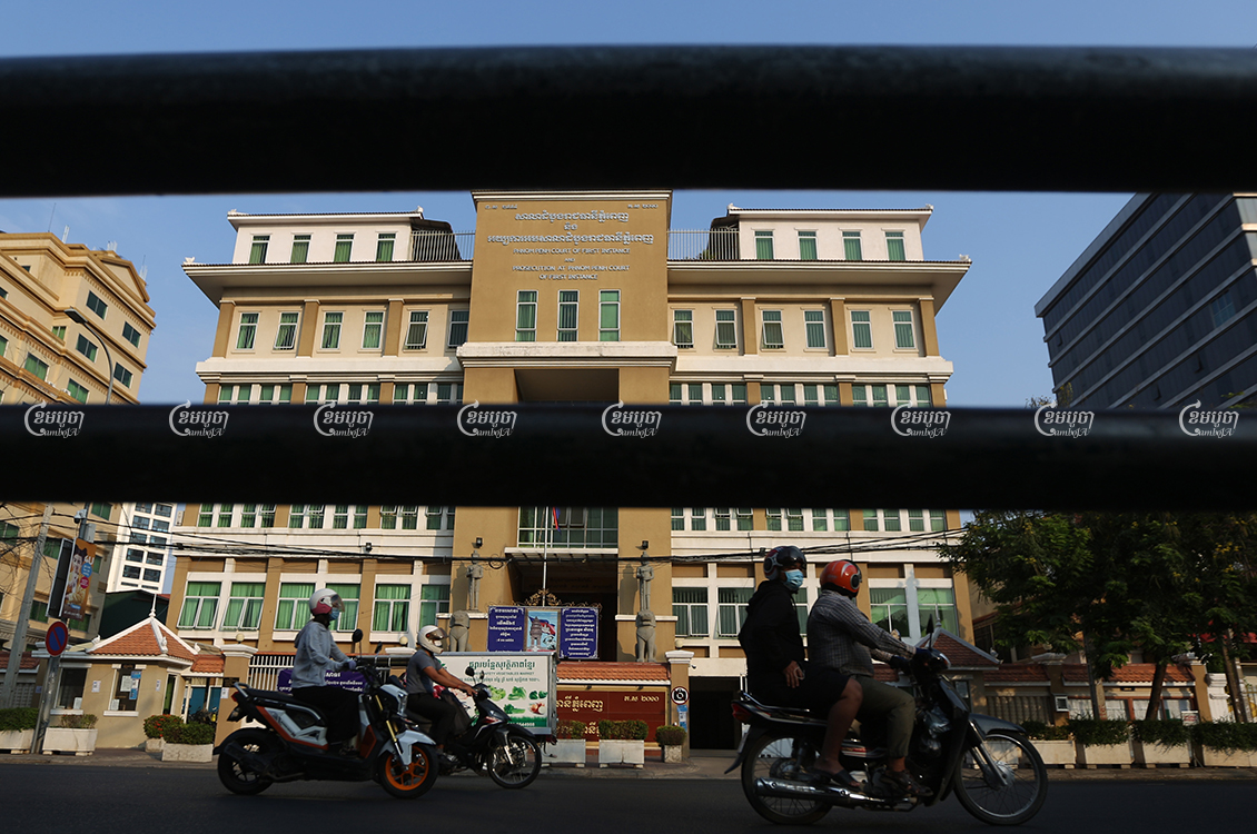 Motorists drive past the Phnom Penh Municipal Court, March 31, 2021. CamboJA/ Pring Samrang